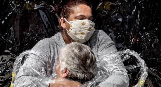 Caption: Rosa Luzia Lunardi (85) is embraced by nurse Adriana Silva da Costa Souza, at Viva Bem care home, São Paulo, Brazil, on 5 August.