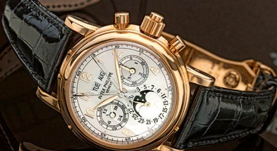 Patek Philippe A Fine Pink Gold Perpetual Calendar Split Seconds Chronograph Wristwatch with Moon-Phases Leap Year and 24 Hour Indication Ref 5004 Mvt 879877 Case 4115668 made in 2004 Estimate 120,000–180,000 USD