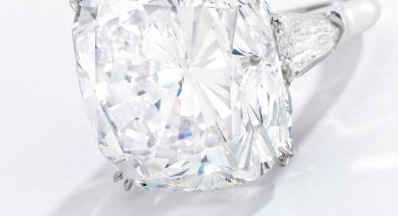 Lot 57 An Impressive Diamond Ring, Harry Winston Set with a cushion-cut diamond weighing 51.52 carats, flanked by two shield-shaped diamonds Estimate $3.5/4.5 million Sold for $3,975,000