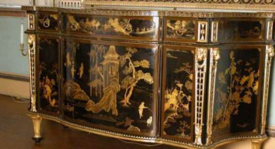 Commode with Chinese lacquer panels and English japanning, attributed to Chippendale, in the State Bed Chamber at Osterley. ©National Trust/Christopher Warleigh-Lack