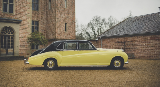 Lot 550 A 1963 Rolls Royce Phantom V  Registration OYM90A  A 1963 Rolls Royce Phantom V with two-tone black and yellow paintwork.  OYM90A - Believed to be the first B-series Phantom produced.  Bodywork: James Young  Retailer: Jack Barclay  Engine: 6.2 twin carburettor V8  Equipment: two way telephone, privacy screen screen, refrigerated boot, fitted decanters and assisted headlight dipping. Estimate:£40,000 - £60,000 Starting bid£28,000