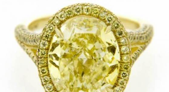 18k Yellow Gold Engagement Ring set with one 6.71 carat Fancy Intense Yellow oval-cut diamond Courtesy of Jewels by Viggi, Greenwich