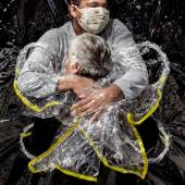WORLD PRESS PHOTO OF THE YEAR & GENERAL NEWS, SINGLES, 1st Prize Title: The First Embrace © Mads Nissen, Denmark, Politiken/Panos Pictures