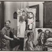 Neel in her Spanish Harlem apartment at 21 East 108th Street with paintings left to right Rag in Window (Pat Passloff (1960), Frank O'Hara no 1 (1960) and Poet Mark McCloskey and His Girl (c. 1960)) © Estate of Alice Neel