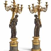 Lot 825 A PAIR OF LOUIS XVI GILT AND PATINATED BRONZE FOUR-LIGHT FIGURAL CANDELABRA ATTRIBUTED TO FRANCOIS REMOND, CIRCA 1785 on bleu turquin marble bases; drilled for electricity. With a later pair of round fluted white marble columns. height 42 in.; max. width 18 in.; width of base 8 in.; depth of base 7 in.; column height 39 1/2 in. 106.5 cm; 45.5 cm; 20 cm; 18 cm; 100 cm Estimate $60/100,000 Sold for $ 112,500