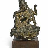A GILT-BRONZE FIGURE OF CINTAMANICAKRA AVALOKITESHVARA LATE TANG DYNASTY / FIVE DYNASTIES Estimate  60,000 — 80,000  USD  LOT SOLD.	2,060,000 USD
