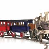 """Nr. 1 Schoenner, Jean seltene Dampflokomotive, Stütztenderlokomotive, Tender, Personenwagen, Marke an der Kesselfront Metallplakette mit den Initialen """"JS"""" in Verbindung mit dem Firmenemblem (Stern + Flügelrad) Limit: 9500 E"""