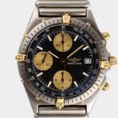 Herrenarmbanduhr, Breitling Uhr und Original-Ansatzband in Stall, Mindestpreis:1.600 EUR