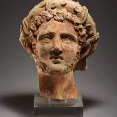 Cahn A. G. A Head of a Man with Wreath  H. 29.7 cm. Orange clay with inclusions Etruscan late 3rd-2nd cent. B.C.