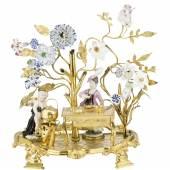 Abb. 87249: Prunkvolle Tafeldekoration, Meissen um 1750. (Porzellan, polychrom bemalt, und Bronze, vergoldet, H. 29, B. 29 cm.), Limit 13.000 €, Zuschlag 13.000 €.