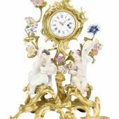Abb. 87250: Kunstvolle Uhr mit Jahreszeitenputti, Meissen Mitte 18. Jh. (Porzellan, polychrom bemalt, und Bronze, vergoldet, H. 26, B. 21 cm.), Limit 14.000 €, Zuschlag 14.000 €.