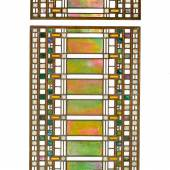 """Lot 91 Property From An Important American Collection Frank Lloyd Wright Two-part Laylight from the Darwin D. Martin House, Buffalo, New York iridized glass, opalescent glass andclearglass in brass-plated """"colonial"""" zinc cames, presently installed in a wood frame (not illustrated)larger panel: 42 5/8 x 21 in. (108.3 x53.3 cm)smaller panel:20x 21 (50.8x 53.3 cm)circa 1903-1905executed by Linden Glass Company, Chicago, Illinois Estimate$80/120,000"""
