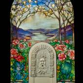 """Lot 215 Property From A Distinguished New York Collection Tiffany Studios """"Magnolia And Peony"""" Window From The Feigenspan Mansion, Newark, New Jersey with the original """"Green Man"""" marble fountain (American, late 19th Century) and painted wood framewith acid-etched markTIFFANY STVDIOS/NEW YORKleaded glass selectively plated on the reverse, marble and painted wood83 1/2 in. (212.1 cm) high, excluding frame46 1/2in. (118.1 cm) wide, excluding framecirca 1905 Estimate $200/300,000"""