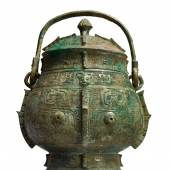 Lot 583 An Extremely Rare and Important Archaic Bronze Ritual Wine Vessel and Cover (You) Shang Dynasty, Yinxu Period Height 11 1/4 in., 28.7 cm Estimate $1.5/2.5 million Sold for $1,935,000