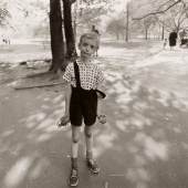 Diane Arbus 'Child with a Toy Hand Grenade in Central Park, N. Y. C.' signed, titled, dated, and editioned '72/75' by Doon Arbus, the photographer's daughter, in ink and with the 'A Diane Arbus Photograph' and reproduction rights stamp on the reverse, framed, exhibition labels on the reverse, 1962, printed posthumously by Neil Selkirk 14 3/4  by 15 in. (27.5 by 38 cm.) Estimate $70/100,000