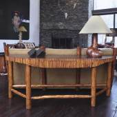Lot 7 Thomas Molesworth A Rare Sofa Back Console Table from Indian Head Ranch, Wyoming with single drawer fir, original brown leather, half-pole trim 301/8 x753/4 x183/4 in.(76.5x192.4x47.6cm) circa 1937 Estimate $25/35,000