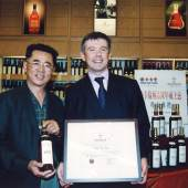 A photo documenting the ceremony, in 2005, during which then The Macallan Brand Ambassador Marc Izatt delivers The Macallan Fine & Rare collection to Wing Hop Fung's ownership. Image courtesy of Wing Hop Fung
