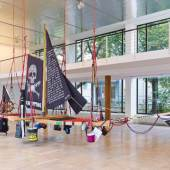 Andrea Bowers, Radical Feminist Pirate Ship Tree Sitting Platform, 2013, Recycled wood, rope, carabiners, misc. equipment and supplies, 360 x 800 x 220 cm, Installation view, Photo: Nick Ash. Courtesy Capitain Petzel, Berlin