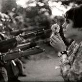 Young girl holding a flower, demonstration against the war in Vietnam, Washington, 1967