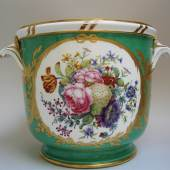Exhibitor: Michele Beiny  Sèvres bottle cooler from the Emperor Joseph II Service Soft paste porcelain decorated on a green ground with two reserves depicting large panels of exquisitely painted flowers and fruit edged with a distinctive gilding pattern of knotted ribbons, palm fronds, flower and laurel garlands, 18.4 x 26 cm.  Marked with interlaced L's, date-letter 'Y' and painter's mark 'nq' for Nicquet  France, 1776