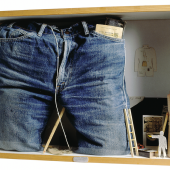 Déserteur de la Légion [Deserter from the Légion], 1974 Mixed media, cardboard, blue jeans, 1964 pocket diary, small wooden ladders, notebook, objects, wood, glass 50x70x16 cm © Fondazione Baruchello, Rome