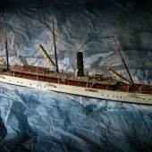 Churchill connection is a painted, wooden model boat 'Namouna' which is 69cm long £300 - £500