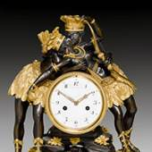 """PRUNKPENDULE """"L'INDIEN ET L'INDIENNE ENLACÉS""""  Directoire, das Modell von J.S. DEVERBERIE (Jean Simon Deverberie. gest. 1824) Paris um 1800.  CHF 250 000 - 350 000"""