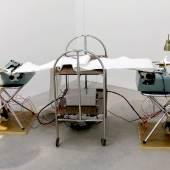 Ian Burns Debate 2014, Typewriters, chairs, table, paper, motors, timing system, 32 x 73 x 27 in. Presented by HilgerBROTKunsthalle, Vienna