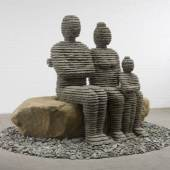 Boaz Vaadia B. 1951 The Family 2008 Bronze, blusestone and boulder 74 x 115 x 115 in. Ed. of 5  Israel-born artist Boaz Vaadia has enjoyed much acclaim since the 1980's. His style has fully evolved into the recognizable forms of figurative sculpture created from layers of chiseled stone. His work reflects the eternal relationship between man and nature and encompasses a universal appeal. Vaadia's stone, chiseled and stacked, arrowhead-like figures have a natural and mysterious quality of prehistoric artworks. This new body of work focuses on bust-style-portraiture using the same stylistic principles, processes and materials as his previous work. Vaadia's sculptures are included in permanent collections of museums around the world including the Metropolitan Museum of Art, the Jewish Museum in New York, San Francisco Museum of Modern Art and the Tel-Aviv Museum.