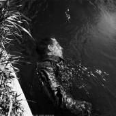 Lee Miller SS guard in canal, Dachau, Germany, 1945 © Lee Miller Archives, England 2014. All rights reserved