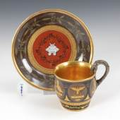 Tasse im etruskischen Stil, KPM BERLIN. A Early 19th Century KPM Berlin Cup with Decorations in the Etruscan Style. 1813 or later, small firing crack at the mouth, restoration at the saucer. Zuschlagspreis:2.800 EUR