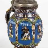 """Musealer Planetenkrug Creussen, datiert """"1658"""" Braunes, salzglasiertes Steinzeug mit in Gold und bunten Emailfarben bemalten Reliefauflagen, Schätzpreis:2.500 - 3.500 EUR"""