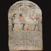 An Egyptian Polychrome Limestone Round-topped Stele  18th Dynasty, Reign of Amenhotep I/Tuthmosis II, circa 1514-1479 B.C. Estimate £120,000-180,000