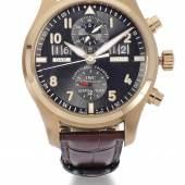ein roségoldener IWC Spitfire Chronograph (Schätzpreis  12.000/18.000 £)