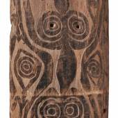 A SISSANO LAGOON SHIELD  Papua New Guinea  Of rectangular form, the scorched surface carved in shallow relief with scrolling fish motifs, two holes for retention of handle (now missing).  153.5 cm. high  Schätzpreis: €7.000 - €9.000, Ergebnis: 18.000