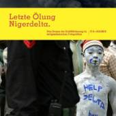 """Georg Osodt: Ein junger Mann hat sich während einer Protestkundgebung am Isaaac-Adaka-Boro-Gedenktag """"Helpdelta Boy"""" auf seinen Körper geschrieben. Kaima, Bayelsa 2005"""