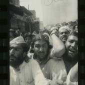 "After 9/11, Pakistan's religious parties organize demonstrations against the possibility of an American attack on Afghanistan. Crowds carry banners written in English: ""Osama is hero of Islam"", and ""Bush trusts in military power, we trust in Allah."" Peshawar, September 2001, Pakistan."