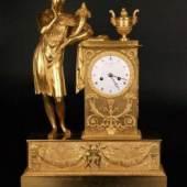 Prunkvolle figürliche Kaminuhr - Frankreich um 1820, feuervergoldete Bronze, Aufrufpreis:2.000 EUR