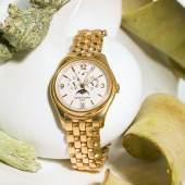 Los 662: Patek Philippe Herrenarmbanduhr. Gehäuse und Armband in Gelbgold 18K.