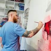 Street Artist Conor Harrington at Work in studio