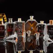 The Macallan 50 Year, Lalique Edition Six Pillars Collection (x 2) To be offered in exclusively commissioned bespoke, hand-made cabinets designed by British craftsman James Laycock Estimate £300,000-450,000 / $350,000-500,000 per lot