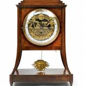 """Lot No. 38  A Biedermeier commode clock with automaton and 'eye turner' inscribed: """"Kaspar Hartek in Wien"""", spring driven, power reserve: 1-3 days, 4/4 hour striking mechanism, repeater function, dial automaton: Blacksmith and Grinder, 'eye turner', enamel dial ring, glazed bezel, inlaid walnut clock case, 45 cm, Austria ca. 1840/50, traces of wear and tear, alterations, the precision of the movement and long-term functioning cannot be guaranteed, 1 pendulum. (c) dorotheum.com"""